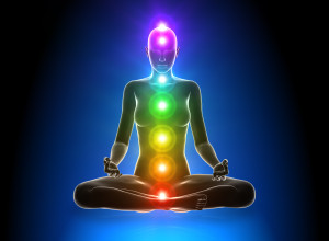 figure in meditation showing chakras