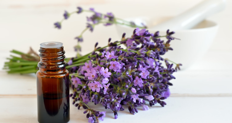 Change Your LifeEssential lavendar oil in dark bottle with lavendar flowers sprig