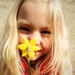 blond girl with flower