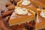 Pumpkin pie on a brown background