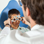 person wearing vision test eye goggles