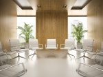 Interior of modern boardroom with conference table and white armchairs