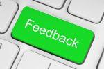 Green feedback button on keyboard close-up